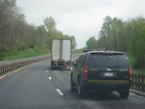 State Trooper Following a Truck